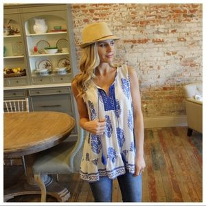 Ivory and blue sleeveless printed tunic